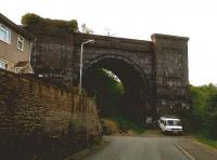 If you need a house with a large external storage area, try Central Street in Ener'glyn, on the North side of Caerphilly. This dramatic arch, which dwarfs the 17-seat minibus below, is all that remains of the Barry Railway viaduct. The BR was known to staff of rival companies as 'the spoilt child of Parliament' - like the GCR, it arrived last and closed first, surviving for only 40-odd years during the peak of coal production in the Rhondda. So this viaduct was used for 45 years, but has been derelict for 73. Sad. The Valley line to Caerphilly passes to the left of this arch; there is a plan to build a new station here. <br><br>[Ken Strachan&nbsp;31/05/2010]