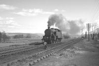 <I>'Right then - deep breaths...'</I>  Fairburn 2-6-4T no 42214 getting psyched up for the task in hand at Beattock South on 15 April 1963. Standing up ahead is 46247 <I>City of Liverpool</I> with the heavy 10am Euston - Perth awaiting the arrival of assistance before tackling the climb to Beattock summit [see image 28174].<br><br>[K A Gray&nbsp;15/04/1963]