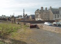 The site of Machrihanish station, terminus of the narrow gauge railway. The line closed in 1931 but there has been very little development on most of the site although some housing has encroached at the west end. However, early photos show there was very little infrastructure at the station and so little remains to indicate what was once here. The hotel, seen here undergoing refurbishment, predated the railway and has long outlived it. [See image 33498] for a map showing the station and surrounding area in 1921.<br><br>[Mark Bartlett&nbsp;26/03/2011]