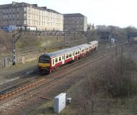 320 321 comes off the Springburn branch at Bellgrove Junction on 26 March 2011 with a Dalmuir service.<br><br>[David Panton&nbsp;26/03/2011]