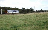 A westbound Sprinter passes the site of Thornton Weighs and shed - now a field with no hint of former use. View looks east. September 2004. [See image 33514]<br><br>[Ewan Crawford&nbsp;15/09/2004]