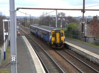 156 502 approaches Bellshill with a stopping service from Edinburgh to Glasgow Central on 26 March.� Giving a continental flavour this unit has for years sported an 'NL' sticker above the offside window!<br> <br><br>[David Panton&nbsp;26/03/2011]