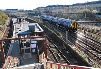 A northbound sprinter passes the Muirhouse Central Junctions on the Glasgow Central approach lines of 1879. This is the view from the steps up to Albert Drive.<br><br>[Ewan Crawford&nbsp;27/03/2011]