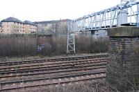 Two piers which supported the signal gantry at Muirhouse Central Junction still stand. Here the Cathcart Circle (two closest lines) leave the route to Barrhead. The view looks east in March of 2011.<br/><br/>Sitting comfortably? Here goes.<br/>The first line on the ground here was the General Terminus line of 1849 (in particular the Terminus Junction to Strathbungo Junction curve). This was followed 30 years later by the approach to the new Glasgow Central terminus (this met the General Terminus line beside the distant pier seen here). Finally in 1894 the Cathcart branch was extended from Cathcart west through Maxwell Park to Muirhouse Central Junction to form a 'circle'. At the same time a short connection was made between Muirhouse Central Junction and Muirhouse North Junction (old) to allow access to Glasgow Central. As a result there was a short section of quadruple track between the old Muirhouse North and old Muirhouse South junctions, a feature arising from the order of openings, but this no longer exists. The lifted section was running off to the left here, in line with the further away pier. The junction names have been re-used for what were Cathcart Junction (later renamed Pollokshields East Junction on opening of the Lanarkshire and Ayrshire Railway to save confusion) and Strathbungo Junction respectively.<br><br>[Ewan Crawford&nbsp;27/03/2011]