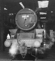 Black 5 no 44781 stands on Carnforth shed in 1968. In common with many surviving locomotives towards the end of steam, number plate, shed plate and any other removable mementoes have long 'disappeared', in this case replaced by white paint. While the shed code 9K shown here refers to Bolton shed, the locomotive spent its last days at 10A Carnforth. 44781, along with classmate 44871, was one of the last BR operational steam locomotives and said its goodbyes on the <I>Fifteen Guinea Special</I> on 11 August 1968, the day before the official BR main line steam ban came into force [see image 30382]. 44781 was officially withdrawn from Carnforth shed by BR at the end of that month. While 44871 ended up in preservation, no 44781 became a (temporary) film star, appearing in the film 'The Virgin Soldiers'. Unforunately it was 'wrecked' as part of the film and cut up on site afterwards.<br><br>[A Snapper (Courtesy Bruce McCartney)&nbsp;//1968]