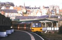 Looking back along the surviving platform towards the station concourse at Whitby in October 1998 as a 3-car DMU prepares to depart with a service to Mddlesborough.<br><br>[Ian Dinmore&nbsp;//1998]