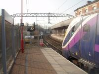 Adelante 180108 gets the right away from Platform 0 at Stockport with a Northern service from Preston to Hazel Grove.  Because the sharp curve through this new platform restricts visibility a <I>Banner Repeater</I> precedes the actual colour light signal.<br><br>[Mark Bartlett&nbsp;24/03/2011]