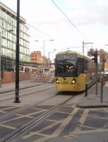 New generation tram 3006 leaves the Shudehill Interchange heading for the next stop at nearby Manchester Victoria on its way to Bury. Shudehill tram stop opened in 2003 and the full bus interchange some three years later. The 3000 series trams are being introduced to cover the services on the new Metrolink lines to Rochdale, Ashton and Didsbury but are being used alongside the existing 1000 and 2000 series vehicles on Bury and Altrincham service in the interim. <br><br>[Mark Bartlett&nbsp;19/03/2011]