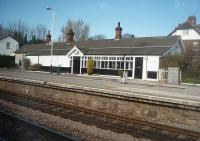 The second station out of Hull on the Selby line is Ferriby where this unusual station building on the eastbound platform is still in commercial use. This picture, taken from a Hull to Sheffield stopping train on 19 March 2011, also shows the through westbound line in the foreground as the platform is on a loop line.<br><br>[Mark Bartlett&nbsp;19/03/2011]