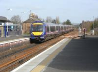 The track configuration at Ladybank Junction means that trains coming<br> off the Perth line have to use the Down line for a couple of hundred <br> yards, and so, if calling at Ladybank, use the 'wrong' platform. This 6-car 170 with an Perth to Edinburgh service is doing just that on 9 April.  This is the third scheduled southbound service in 13 minutes! A quiet north Fife village can't enjoy that level of service all day of course, but like some other Scottish stations it probably sees more trains now than it ever has.<br><br>[David Panton&nbsp;09/04/2011]
