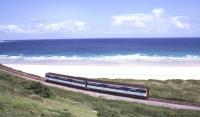 The Cornish coast around Carbis Bay, photographed in the summer of 1999, with a DMU passing along the St Ives branch bound for St Erth and the junction with the Great Western main line.<br><br>[Ian Dinmore&nbsp;21/06/1999]
