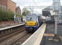 An Edinburgh to Helensburgh service, formed by Saltire liveried 334006, pauses at Coatbridge Sunnyside after a run along the new <I>A to B line</I>. Resurfacing and other work was taking place on the car park and station forecourt here on this date. <br><br>[Mark Bartlett 14/04/2011]