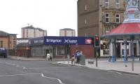 East End Style. The street entrance of Bridgeton (formerly Bridgeton <br> Cross) station on 13 April 2011. At the cross is the 'Brigton Umbrella', of 1875 looking in fine shape, though without its original seating.<br><br>[David Panton&nbsp;13/04/2011]