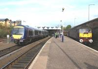 As 170412 arrives on Platform 3 at Dundee with a terminating <br> service from Edinburgh, the Compass Tours <I>Forth and Tay Bridges Express</I> waits on platform 1 with the return leg of the tour on 15 April 2011.<br> <br><br>[John McIntyre&nbsp;15/04/2011]