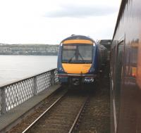 Out on the Tay Bridge on 15 April unit 170414 will shortly reach the high girders with an Edinburgh bound service, as the Compass railtour heads north near the end of the outward leg of its journey from Blackpool.<br><br>[John McIntyre&nbsp;15/04/2011]