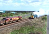 66105 with a freight meets Deltic no D9000/55022 <I>Royal Scots Grey</I>, currently on hire to GBRf, just west of Freemans Crossing, North Blyth, on 12 April 2011. [See image 33624]<br><br>[Colin Alexander&nbsp;12/04/2011]