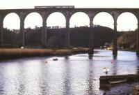 A 2-car DMU bound for Gunnislake crosses the Tamar on Calstock Viaduct in January 1990. The viaduct, built in 1908, carries the railway 120 feet above the river between Bere Alston and Calstock.<br><br>[Ian Dinmore&nbsp;15/01/1990]