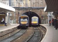 Two Scotrail Class 170s pass in the tunnel mouth at Haymarket. 170418 on the left is heading for Waverley and the approaching 170414 is bound for Dunblane. <br><br>[Mark Bartlett&nbsp;14/04/2011]