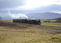 On one of the long straights north of Dalwhinnie, Black 5s 45407 <I> The Lancashire Fusilier </I> and 44871 haul support coaches towards Inverness.<br> <br><br>[John Gray&nbsp;17/04/2011]