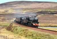 <I>The Great Britain IV</I> south of Kinbrace on 18 April with Black 5s 44871 and 45407 <I> The Lancashire Fusilier </I> having just crossed the River Helmsdale. Discreetly tagged on at the tail end is 47 760.<br> <br><br>[John Gray&nbsp;18/04/2011]