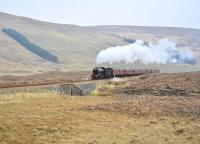 After a water stop at Achnasheen on 19 April, K4 no 61994 <I> The Great Marquess </I> nears the summit of the�long climb west from the station with�<I> The Great Britain IV </I> special on its way to Kyle of Lochalsh.<br><br>[John Gray&nbsp;19/04/2011]