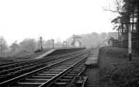 View north over Kershopefoot station, Cumbria, on the final Friday of operations over the Waverley route, 3 January 1969. The border lies just beyond the signal box / level crossing and follows the course of the Kershope Burn at this point. [See image 31490]<br> <br><br>[K A Gray&nbsp;03/01/1969]