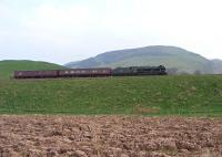 46115 with support coaches passes Craig Rossie on 20 April on the approach to Auchterarder.<br><br>[John Robin&nbsp;20/04/2011]