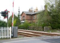 The remains of Strensall station on the north eastern outskirts of York in April 2009. Located on the Scarborough line, Strensall lost its passenger service in the 1930s. View is south west towards York from the level crossing with Strensall signal box behind the camera [see image 50361]<br><br>[John Furnevel&nbsp;19/04/2009]