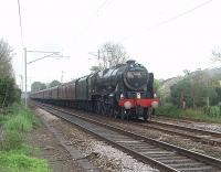 Day 6 of the 2011 <I>Great Britain IV</I> tour sees 46115 <I>Scots Guardsman</I> heading the Glasgow to Preston leg south through the site of closed Bolton-le-Sands station after an extended water stop at Carnforth.<br><br>[Mark Bartlett&nbsp;21/04/2011]