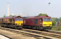 DBS 60040 <I>The Territorial Army Centenary</I> & 66081 stand in Didcot station yard on 21 April with Didcot power station in the left background.<br> <br><br>[Peter Todd 21/04/2011]