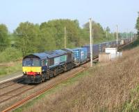 DRS intermodal service 4M34 from Coatbridge to Daventry heading south past the hot axle box detector (HABD) at Coppull Hall on the <br> WCML near Standish on 22 April 2011.<br> <br><br>[John McIntyre&nbsp;22/04/2011]