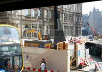 View from a no 37 bus at the east end of Princes Street on 21 April 2011. Hoarding surrounds the works at the top of Waverley Steps with pedestrian diversions in place. To the right is the temporary route between Princes Street and Waverley Station via Princes Mall.<br><br>[John Furnevel&nbsp;21/04/2011]