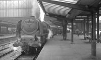 Stanier Pacific no 46248 <I>City of Leeds</I> off Crewe North shed stands at Carlisle platform 3 on 25 April 1964 shortly after bringing in the 9.25am Crewe - Perth. The locomotive is about to be relieved, following which it will make its way to Upperby shed.<br><br>[K A Gray&nbsp;25/04/1964]