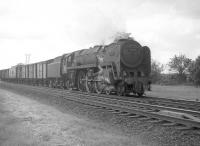 Britannia Pacific no 70011 <I>Hotspur</I> just south of Gretna Junction around 1963 with what is thought to be the Aberdeen - Manchester fish train.<br><br>[A Snapper (Courtesy Bruce McCartney)&nbsp;//1963]