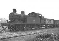 Stanier 2P 0-4-4T no 41908 stands on Buxton shed in May 1960 nearly 6 months after withdrawal. The locomotive was eventually cut up at Gorton works in the spring of 1961. <br><br>[K A Gray&nbsp;20/05/1960]
