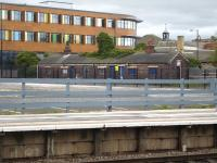 The remaining building from the former goods yard alongside Wakefield Westgate Station, seen here on 5 April 2011. [See image 33629]. It was demolished in 2013 when the new station main building was being built on the cleared area seen in the foreground, that continues to the multi-storey car park erected to left of view.<br><br>[David Pesterfield&nbsp;05/04/2011]