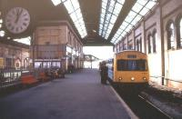 A terminating DMU service stands under the overall roof at platform 1 of Blackburn station in April 1995.<br><br>[Ian Dinmore /04/1995]