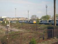 DBS <I>Fertis</I> liveried class 56 locomotives, previously employed in France on construction of new high speed routes, now stored at the south end of the former Crewe Diesel Maintenance Depot. Photographed from a passing Crewe - Shrewsbury all stations shuttle service on 18 April 2011.<br><br>[David Pesterfield&nbsp;18/04/2011]
