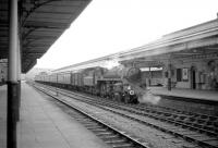 A photograph thought to have been taken in late February or early March 1967 at Aberystwyth, showing Standard Class 4 4-6-0 no 75033 with the down <I>Cambrian Coast Express</I> [see image 26171].  The last steam hauled CCE ran a short time later on 4 March 1967.<br><br>[Robin Barbour Collection (Courtesy Bruce McCartney)&nbsp;//1967]