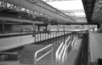 View from behind the buffers on the former platform 13 at Aberdeen on 9 June 1973 looking north with platforms 12, 11 and 10 to the left. The platform canopies remain on this side of Guild Street bridge but on the far side they have all been demolished. Today (2011) you would be looking under Atholl House. [See image 12310] for the view back from Guild Street Bridge into the station 33 years later.<br><br>[John McIntyre&nbsp;09/06/1973]