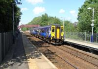 A sunny, warm May Day bank holiday in Glasgow sees an East Kilbride service, formed by unit 156 436, preparing to pull away from the platform at Giffnock.<br><br>[David Panton&nbsp;02/05/2011]