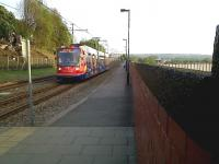 A Sheffield 'Supertram' heads North along the tracks above the retaining wall to the East of Sheffield station on 24 April 2011. <br><br>[Ken Strachan&nbsp;24/04/2011]