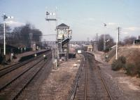 A fine array of semaphore signals glimpsed at Dyce station, looking back from the brake van of the daily Fraserburgh-Aberdeen goods on 27th March 1973.<br><br>[David Spaven&nbsp;27/03/1973]