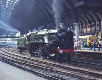 BR Standard class 9F 2-10-0 no 92220 <I>'Evening Star'</I> waits on the down centre road in York station on 4 July 1976 prior to taking over the NELPG's 'Scarborough Spa Flyer', which it will work to the seaside resort and back. <br> <br><br>[Bill Jamieson&nbsp;04/07/1976]