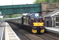 <I>The Royal Scotsman</I> runs through Polmont station on 6 May 2011 en route to Wemyss Bay. WCRC 37685 is at the head of the train with 57001 bringing up the rear.<br><br>[Brian Forbes&nbsp;06/05/2011]