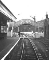Walkerburn station viewed from the rear of the 11.15 Galashiels-Peebles-Edinburgh train on the last day of service, 3rd February 1962.<br><br>[Frank Spaven Collection (Courtesy David Spaven)&nbsp;03/02/1962]