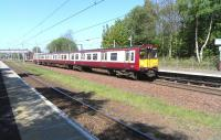 314 203 heading for Glasgow at Hillington West on 2 May 2011.<br><br>[David Panton&nbsp;02/05/2011]