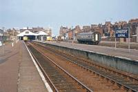 On June 29th 1977, the station name board declared this destination as Lowestoft Central, despite the fact there was no other station in the town that might be confused with it. Up until May 1970, however, there was also Lowestoft North on the line to Yarmouth South Town. Visible in this view are the DMU services to Norwich and Ipswich, a Class 03 shunting locomotive and apparently failed stock from the Lowestoft - London service.<br><br>[Mark Dufton&nbsp;29/06/1977]