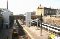 View west over Haymarket station on 21 April 2011 showing the newly commissioned lifts now providing disabled access to platforms 2,3 and 4. A Waverley - Queen Street shuttle has just arrived at 4 while the 09.52 Aberdeen - Kings Cross HST is in the process of leaving platform 1. <br><br>[John Furnevel&nbsp;21/04/2011]