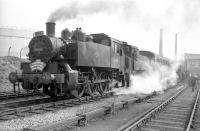 USA 0-6-0 tanks 30064+30069 at Fawley on 9 April 1967 with the LCGB Hampshire Branch Lines Rail Tour. The pair had taken over the special from 34057 at Southampton Central. <br><br>[Robin Barbour collection (Courtesy Bruce McCartney)&nbsp;09/04/1967]